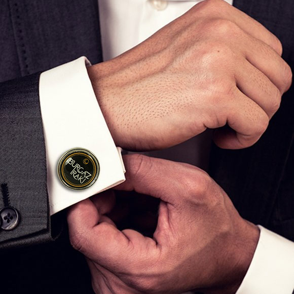 Metal cufflink with doming